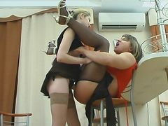 Naughty gal shoving her strap-on into sissy guy